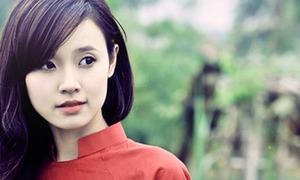 Midu diện áo dài thướt tha trên báo Trung Quốc
