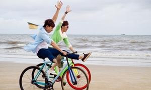 Isaac, S.T (365) làm xiếc xe đạp trên bãi biển