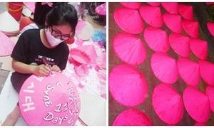 Fan SNSD phủ hồng 500 nón lá đón thần tượng