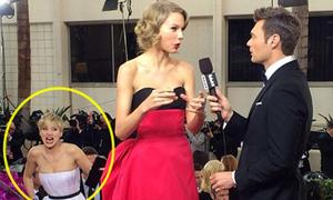Jennifer Lawrence bày trò phá Taylor Swift trên thảm đỏ