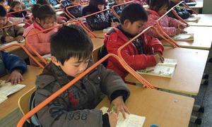 Trường học lắp khung thép chống cận thị