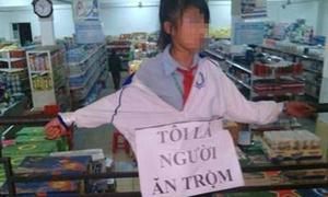 Người bắt nữ sinh đeo bảng 'tôi ăn trộm' có thể lĩnh 3 năm tù