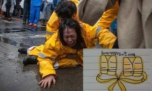 Hai thi thể học sinh trong phà Sewol buộc vào nhau bằng phao