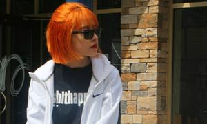 Chi Pu khoe tóc cam chất chơi tại Canada