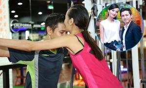 Lê Thúy hôn trộm chồng điển trai trong phòng gym