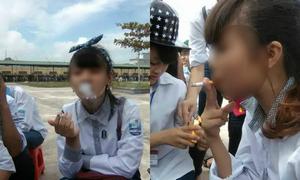 Nữ sinh hút thuốc giữa sân trường