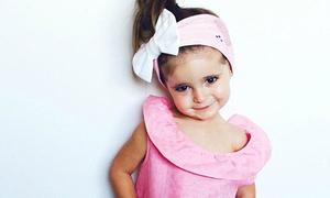 Mẫu nhí 2 tuổi được nhận váy áo miễn phí quanh năm