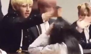 V BTS gây tranh cãi vì giật tóc của fan nữ