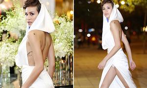 Phương Mai lộ quần bảo hộ khi mặc váy xẻ tà cao vút