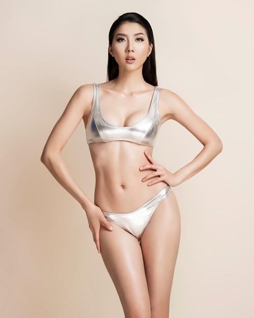 ngoc-quyen-dien-bikini-khoe-ve-sexy-cua-gai-mot-con
