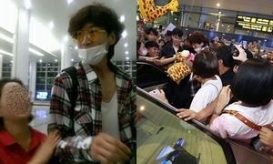 Fan cuồng đu bám Lee Kwang Soo gây 'náo loạn' tại sân bay Nội Bài