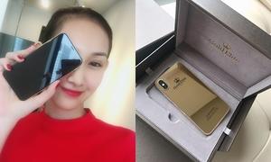 Cô gái Việt đầu tiên sở hữu iPhone X vàng nguyên khối 24K