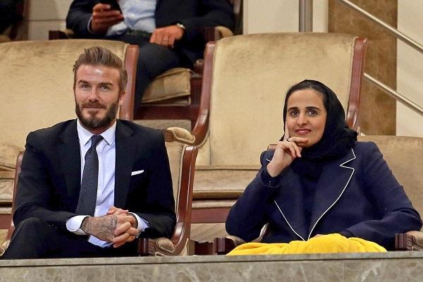 Công chúa ngồi cạnh cựu cầu thủ David Beckham trong một sự kiện.