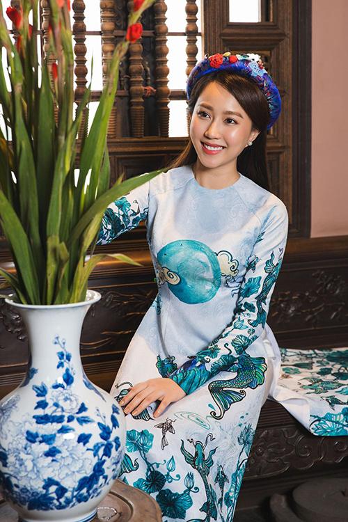 Hot girl Lona Huỳnh khoe vẻ đẹp ngọc nữ với áo dài Tết - 5