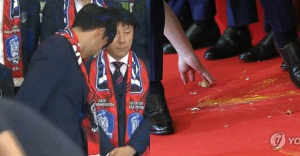 Oppa tuyển Hàn Quốc bị fan ném trứng thối khi về nước