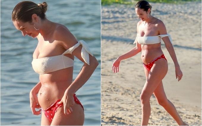 """<p> Sau khi loạt ảnh Candice Swanepoel diện bikini tắm biển ngập tràn các trang báo, chân dài Nam Phi đã hứng chịu nhiều lời chê bai về vóc dáng """"bèo nhèo"""", xồ xề sau sinh.</p>"""
