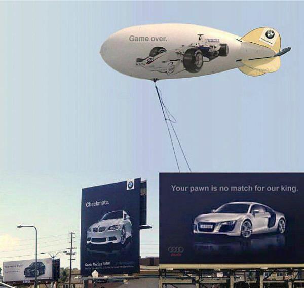 Audi tiếp tục ăn miếng trả miếng khi đưarathông điệp Quân tốt của anh không lại được vua của tôi đâu kèm theo một khinh khí cầu gắn dòng chữ Game Over.