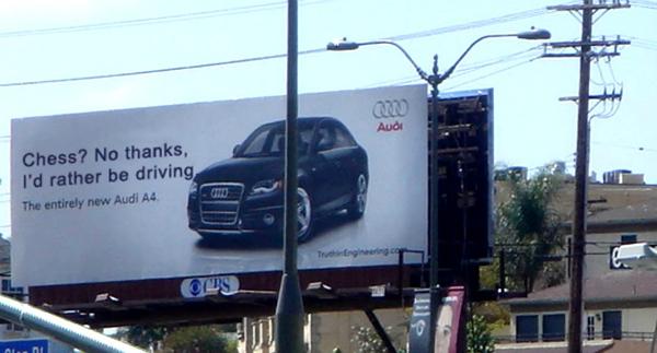 Ngay sau đó, Audi đã chế giễu động cơ chỉ dành cho xe máy của BMW với thông điệp: Chơi cờ vua ư? Thôi cám ơn, tôi thích lái xe hơn.