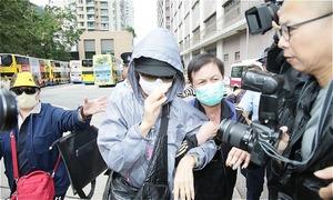 Chị gái Lam Khiết Anh mặc kín mít đến nhận thi thể em