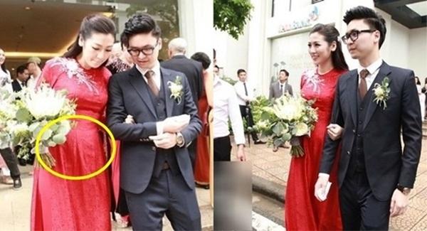 Trong ngày cưới, bức ảnh vòng hai lùm lùm của người đẹp cũng khiến không ít người thắc mắc.