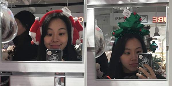 Chae Young (Twice) thích thú đeo thử những món phụ kiện Giáng sinh để chụp ảnh tự sướng.