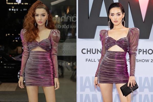 Chiếc váy cắt xẻ táo bạo của NTK Chung Thanh Phongmang đến hình ảnh mới mẻ cho Bích Phương. Cô và Khánh Linh The Face có màn đụng hàng bất phân thắng bại khi cùng mix mẫu đầm này với boots cổ ngắn và khuyên tai cá tính.