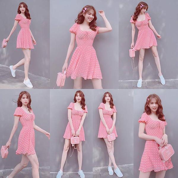 Ngọc Trinh tung tăng xuống phố với váy hồng nhí nhảnh.