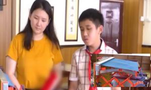 Cậu bé 12 tuổi chế tạo giá phơi đồ tự chạy mưa