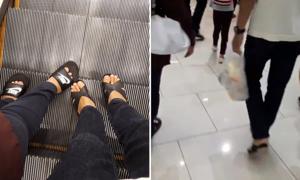 Chàng trai Malaysia nổi tiếng vì đổi giày cao gót cho mẹ khi shopping
