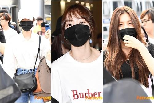 Các cô gái G-Friend che chắn vẻ mệt mỏi khi trở về Hàn.