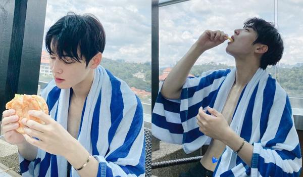 Cha Eun Woo đinghỉ dưỡng, thoải máigặm hamburger sau khi bơi. Anh chàng dùng khăn tắm che chắn cơ thể, đến rốn cũng tỉ mỉ che bằng hình trái tim.