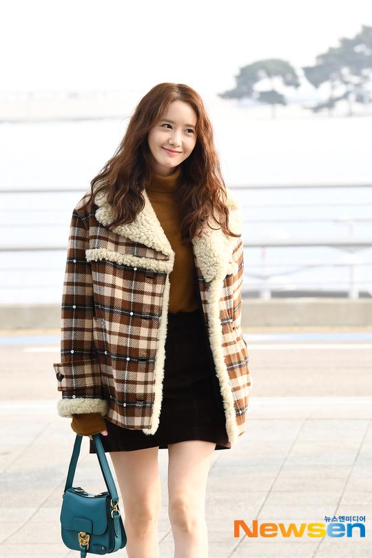 Yoona tóc xù đáng yêu, BTS che kín ở sân bay