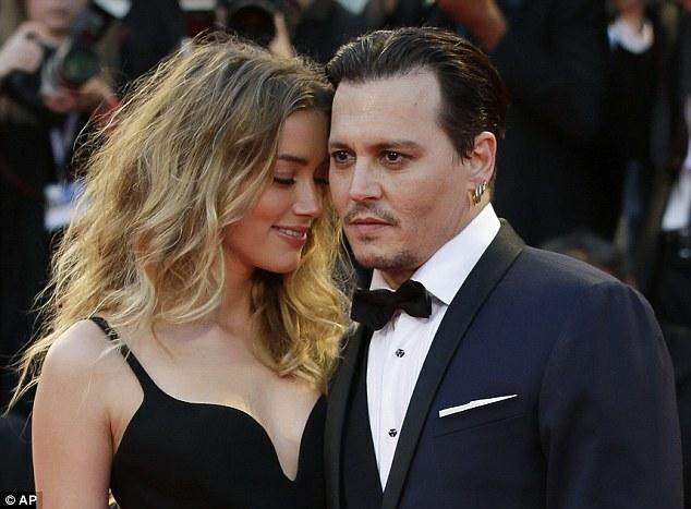 Amber Heard và Johnny Depp. Ảnh: AP.
