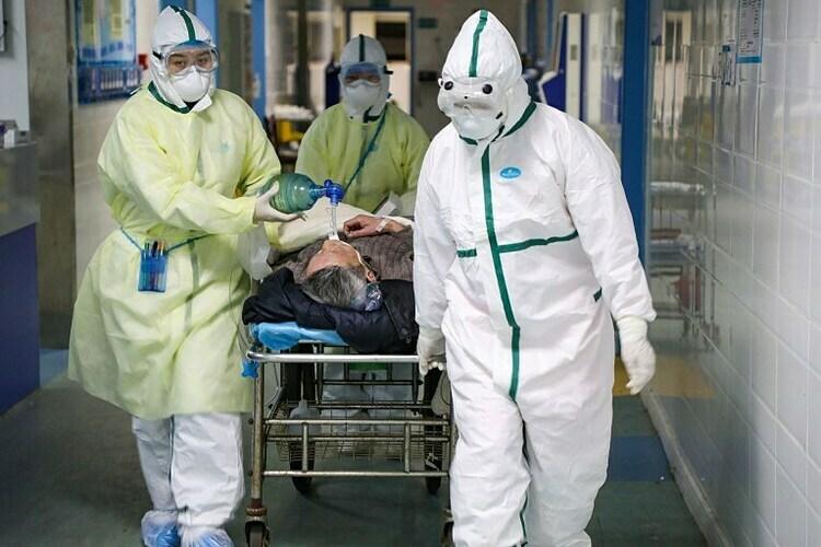 Số người chết vi Covid-19 vượt con số 1000 trên toàn thế giới. Ảnh: Reuters.