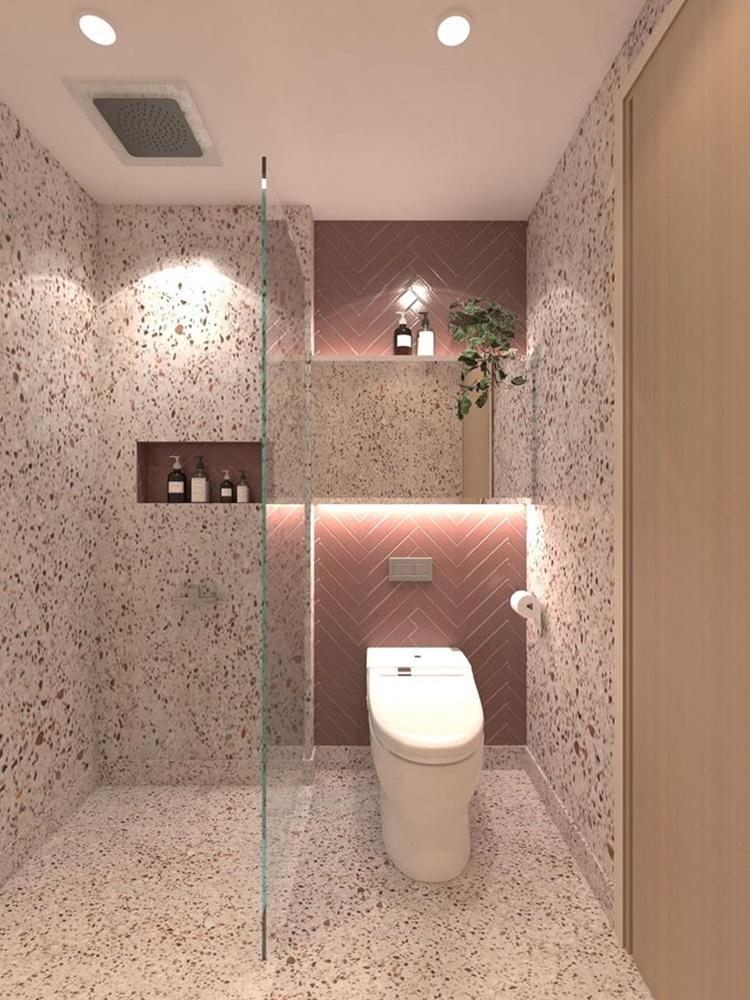 Toàn bộ nhà vệ sinh được cô lát gạch lại để đồng bộ với tổng thể ngôi nhà. Tủ nhà vệ sinh cũng được thiết kế giấu kín bằng cách làm trùng màu với gạch.