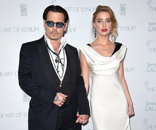 Johnny Depp và Amber Heard thời mặn nồng. Ảnh: FilmMagic.