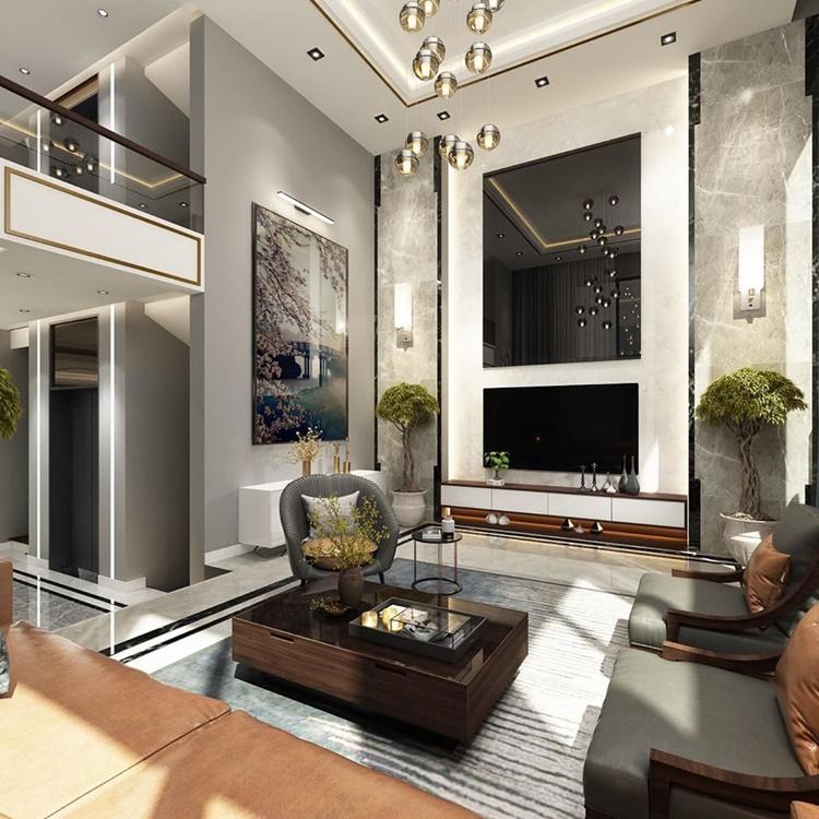 Giữa phòng khách, Lê Hoàng đặt một tấm kính cùng màu với tivi, làm phòng khách thêm sang trọng. Đa phần nội thất trong căn hộ sử dụng tông màu xám, nâu, tạo cảm giác gần gũi, ấm cúng.