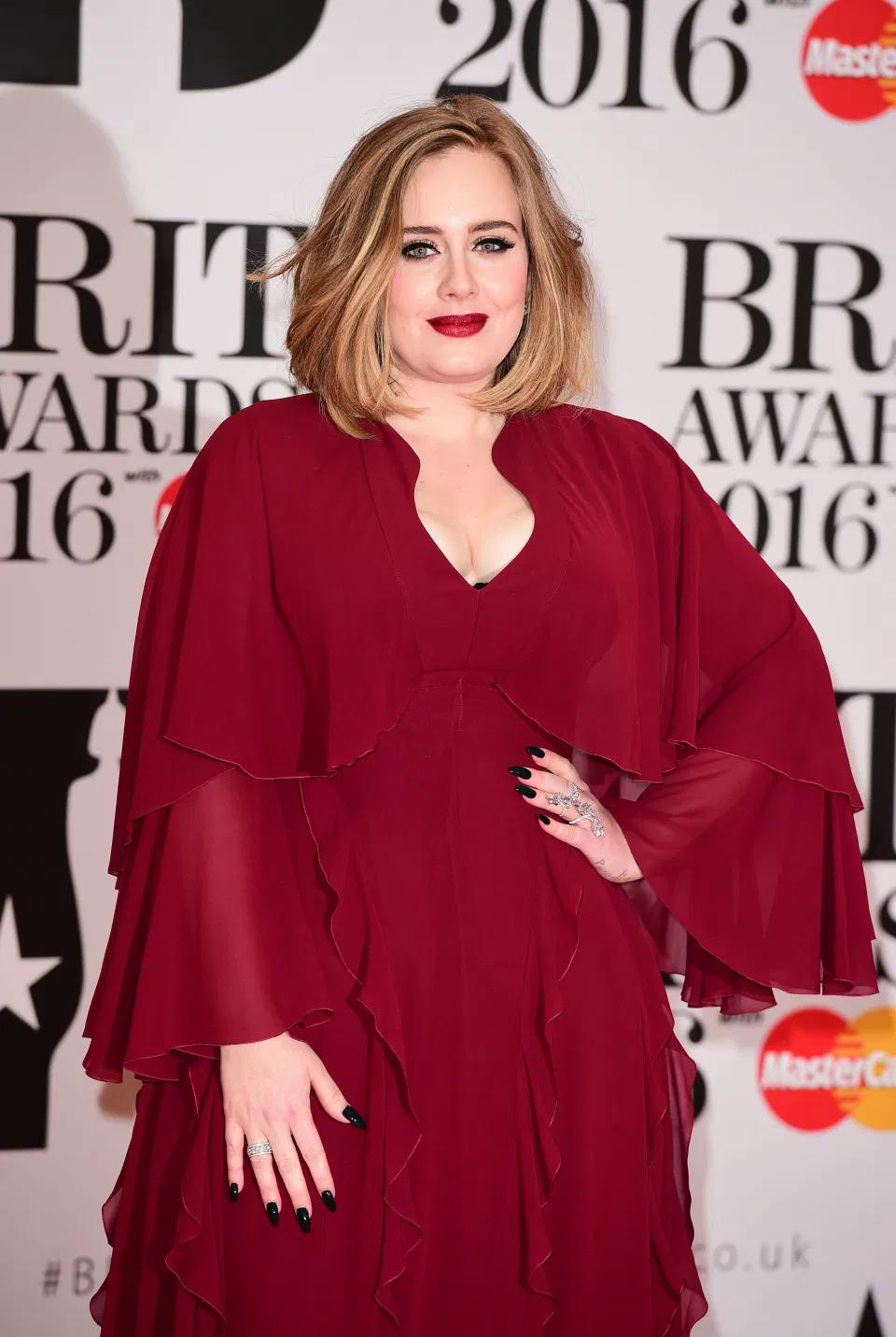 Adele mũm mĩm cách đây 4 năm. Ảnh: PA