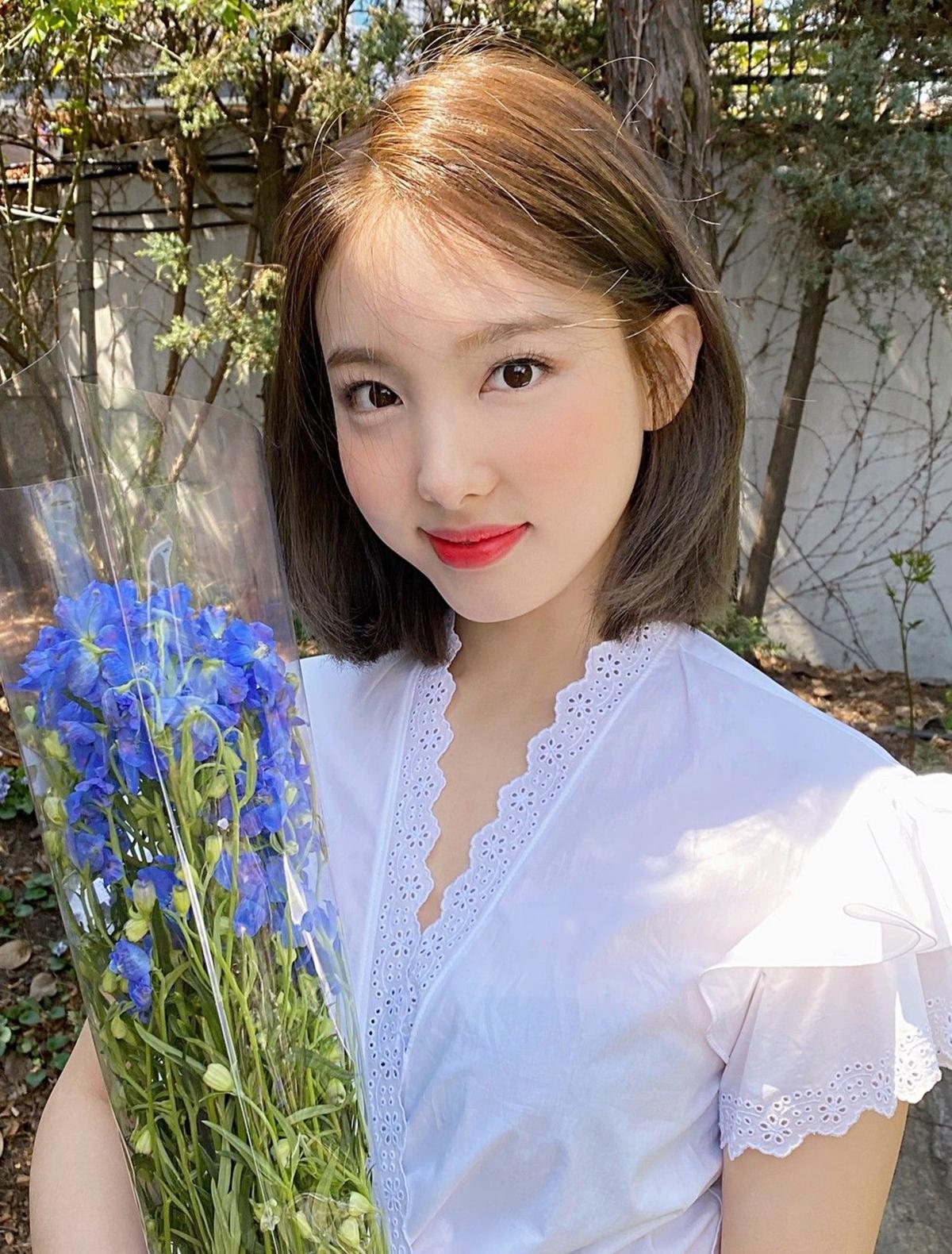 Côi F5 hình ảnh bằng style tóc ngắn năng động trong đợt comeback More and More hồi tháng 6.