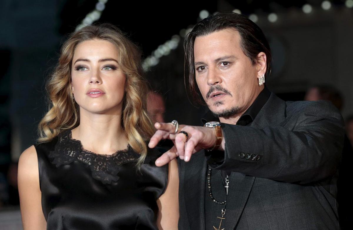 Amber Heard và Johnny Depp ly dị sau 15 tháng kết hôn. Giữa họ xảy ra nhiều vụ xây xát, liên tục tố bị đối phương bạo hành. Ảnh: Reuters.
