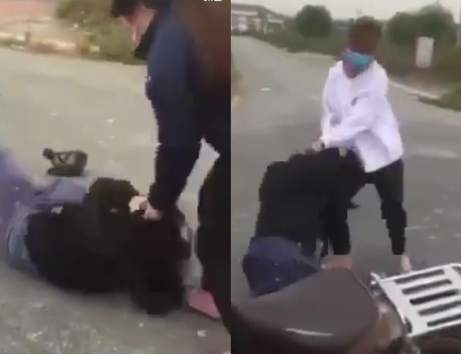 Hình ảnh nữ sinh bị nhóm người dùng chân đấm, đạp gây phẫn nộ. Ảnh:Cắt từ clip