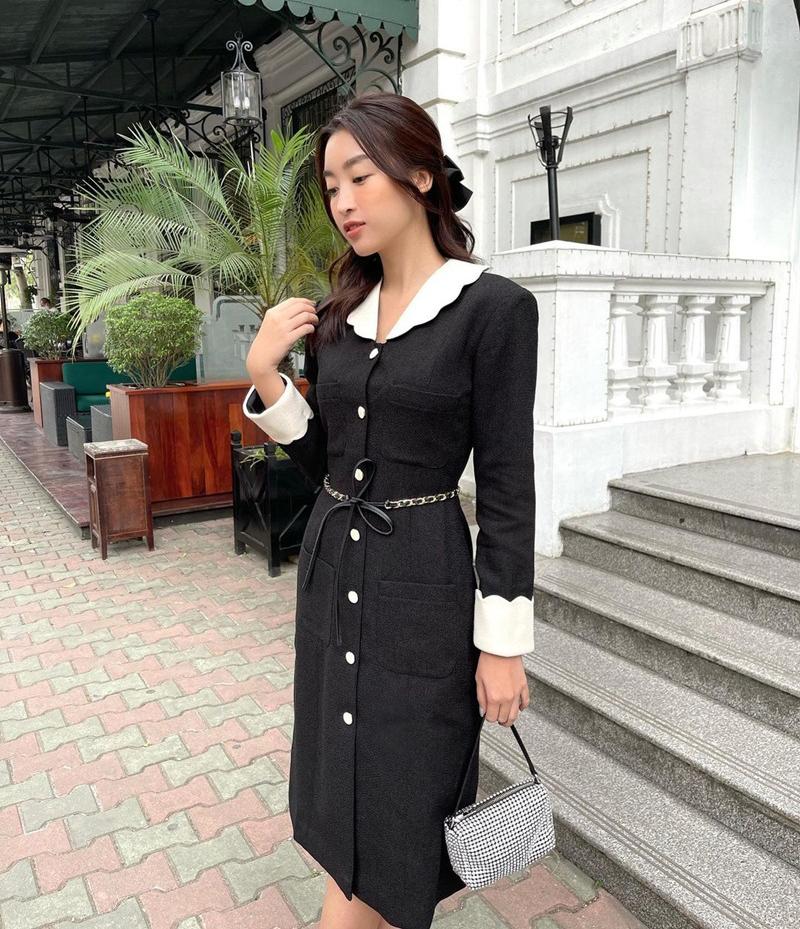 Đỗ Mỹ Linh như một cô tiểu thư cổ điển với váy đen trắng, kết hợp cùng kiểu tóc kẹp nửa.