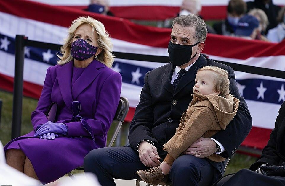 Jill Biden (left) watches her husband speak alongside Hunter Biden (center) and baby Beau, named for his late brother.