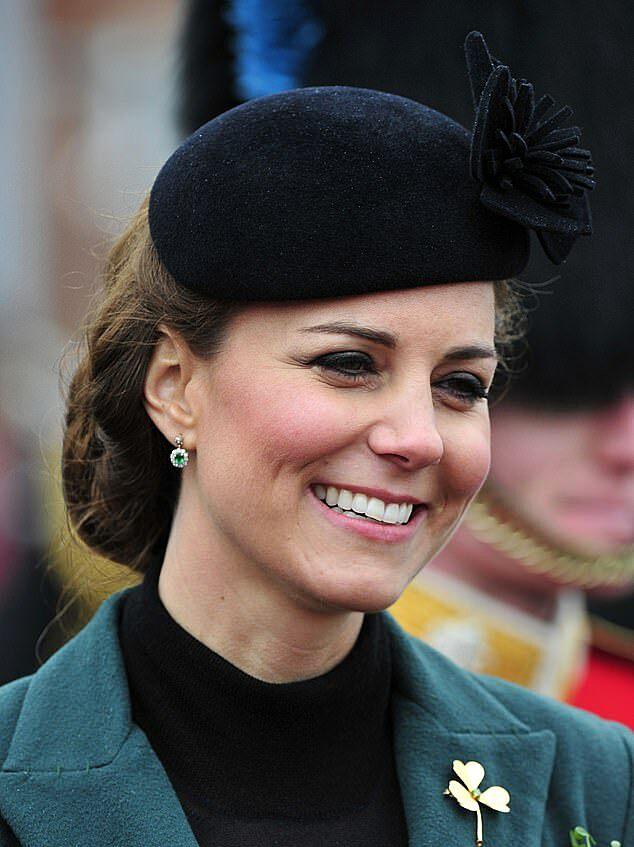 Mái tóc của Kate gần gọn gàng vào nếp hơn sau khi làm dâu Hoàng gia Anh. Ảnh chụp năm 2013. Ảnh: AFP.
