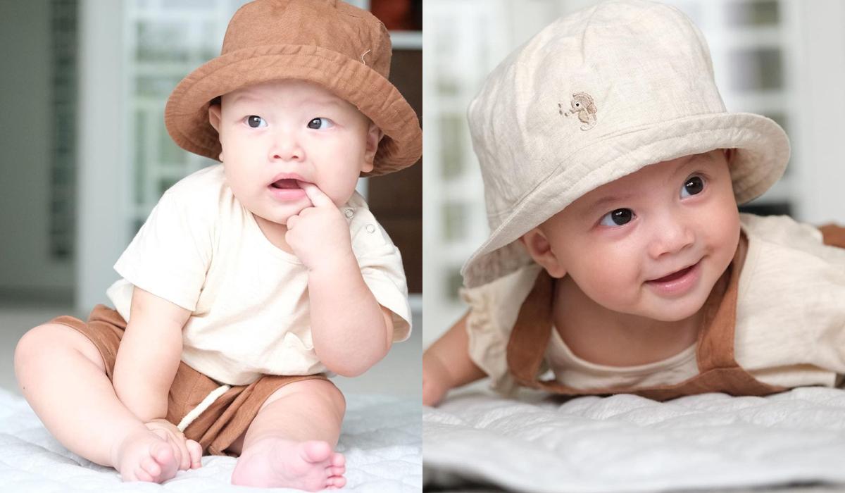 Những set đồ của hai nhóc tì càng thêm xinh yêu hết cỡ khi được bố mẹ cho kết hợp cùng mũ, bờm... đầy phong cách.