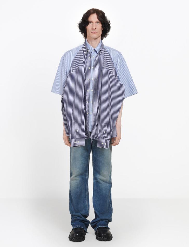 Double shirt ra mắt cùng bộ sưu tập với chiếc T-shirt shirt cũng thu hút không ít sự chú ý với sự dị của mình. Mẫu áo thiết kế gồm hai chiếc áo sơ mi kẻ sọc lồng ghép nhau. Cách mặc tương tự như T-shirt shirt, có hai sự lựa chọn cho khách hàng: mặc chiếc sơ mi ngắn phía sau hoặc sơ mi tay dài phía trước. Có lẽ đều là hai chiếc áo sơ mi nên mức giá có phần cao hơn T-shirt shirt, với mức 1345 USD.